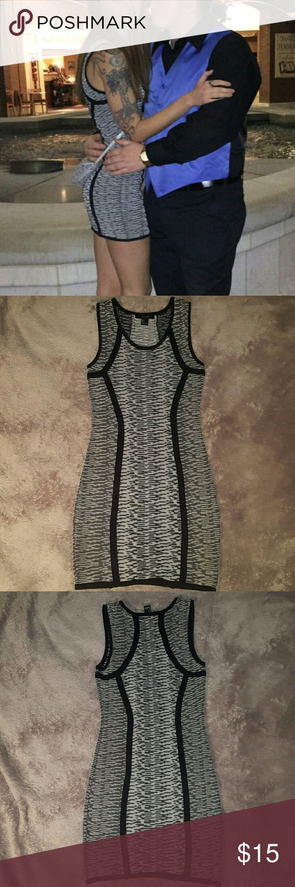 Forever 21 black and white bodycon dress Mini. Really flatters your curves. Great condition, only worn once to an event. Black and white. Looks grey from far away. Forever 21 Dresses Mini