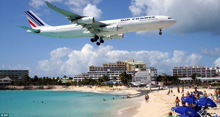 In we go: An Air France plane descends at Maho Beach on the resort island of St Maarten in the Caribbean