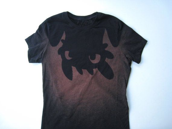 Upside down Toothless from How to Train Your Dragon by Ragnarokkr Awesome Toothless shirt made with stencil and hand bleached to show silhouette of Toothless upside down. SO CUTE!! Available in Women's, Kids and men's sizes. One-of-a-kind as each stencil is hand cut and used only once. #httyd2 #Toothless