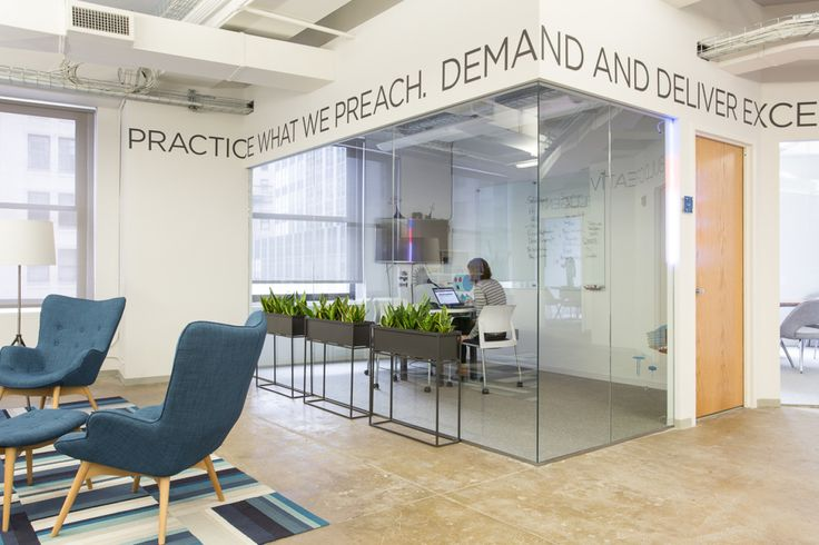 Inspiring words hang over the office to remind employees of StellaService's mission statement.