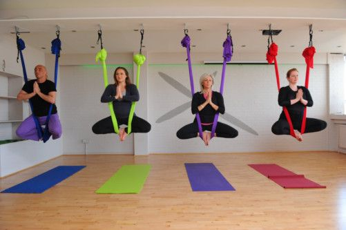 Tommy Hepburn, Hazel Sheppard, Julie Hanson and Claire Davidson practise aerial yoga at the Chi & Co yoga studio in Pollokshields, which has had to be specially reinforced with steel beams. Photographs: Robert Perry