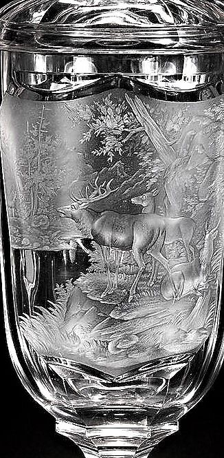 Detail -  A large Bohemian goblet and cover, circa 1870-80 Probably engraved by Johann F. Hoffmann, the tall broad-fluted bowl with a shield-shaped cartouche finely engraved with two deer and a stag beside a lake in a forest clearing, on a knopped and faceted stem and hexagonal foot, the cover with a spire finial, 50.5cm high (2
