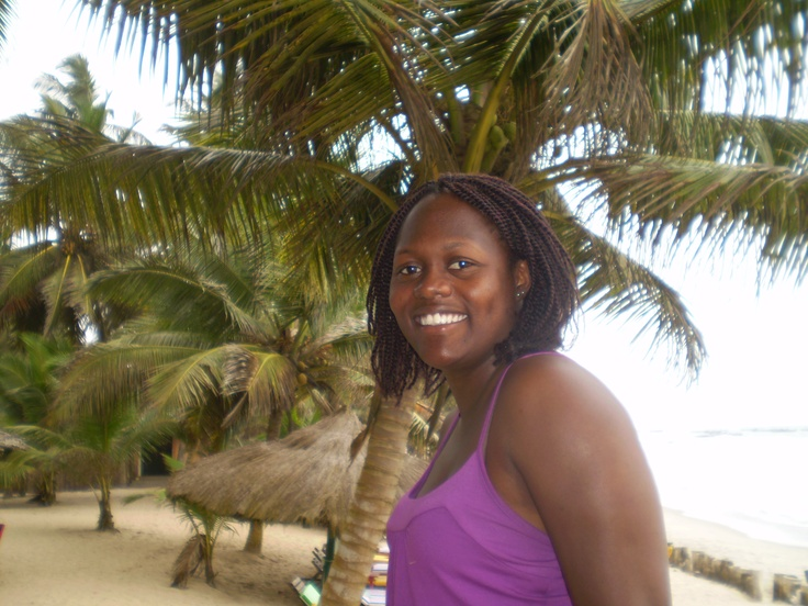Africa specialist Lily Baffour poses on the sandy beaches of Ghana's Cape Coast.