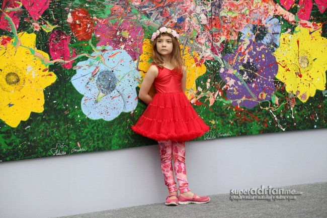 """Aelita Andre, 8, female Australian child art prodigy. World renowned pop art artist and illustrator James Warhola and Aelita collaborated on the painting """"Chengdu Garden"""". It is the two artists' rendition of a prosperous and harmonious modern Chengdu as well as the essence of Sino-Ocean Taikoo Li Chengdu's colourful and diverse character."""