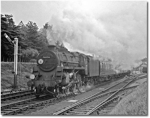 A BR Riddles Class 4 starts out from New Milton with an Eastleigh to Bournemouth local train late in 1961. Hampshire, UK. Negative scan.