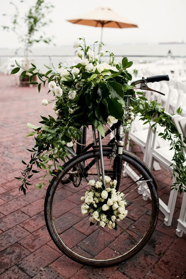Cruise bicycle covered in blooms | Chic Red Hook Brooklyn New York Bohemian Wedding | Photograph by Brookelyn Photography  http://www.storyboardwedding.com/chic-red-hook-brooklyn-liberty-warehouse-wedding/