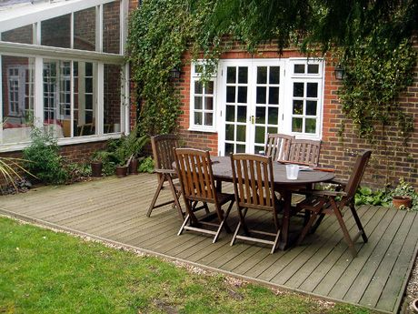 Walk Out Of The French Doors Onto A Flush Low Level Deck