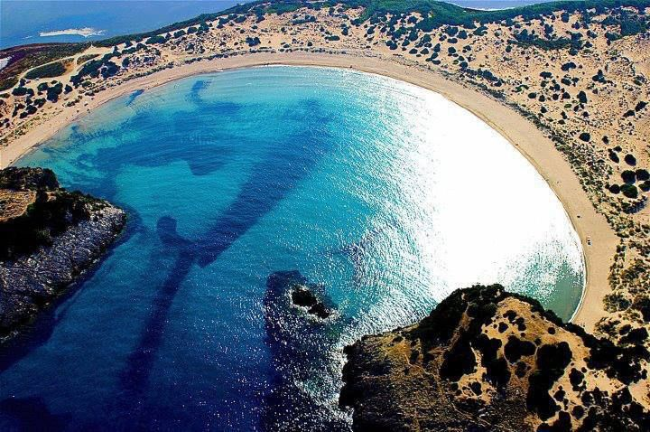 This has got to be one of the most impressive beaches on the planet with the symmetrical Omega shape that makes it unique. Voidokilia Beach is the only geological formation of its kind. It is located in the Messinia region of the Peloponnese.