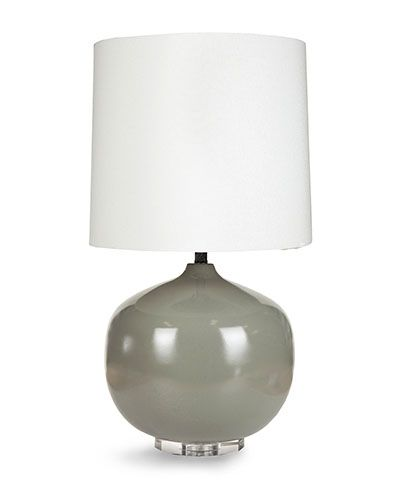 """Bubble Lamp - Grey A glossy sphere of grey-glazed ceramic makes a modish impression, adding weightless but grounding bulk to your space in order to direct the eye and define areas to sit or stand. The ideal companion to such nuanced considerations of décor, the Grey Bubble Lamp is crowned with an unexpectedly tall white drum shade for striking proportions. H:15"""" W:16"""" D:17"""""""