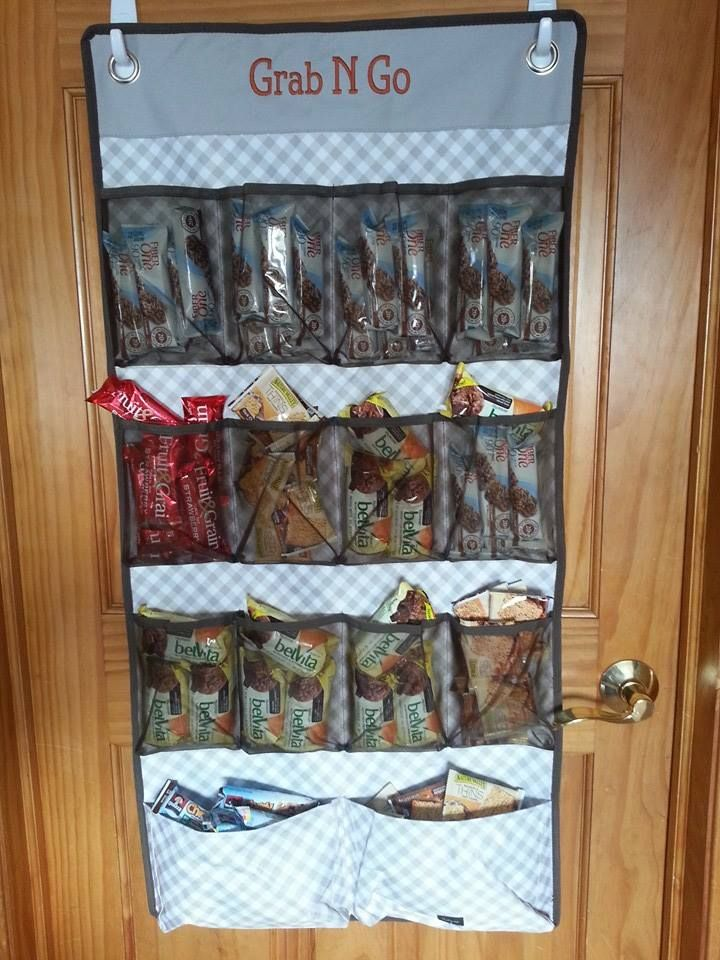 My wall of snacks is complete with the Thirty-one Hang Up Space Saver....holding 16 boxes of snack bars!!