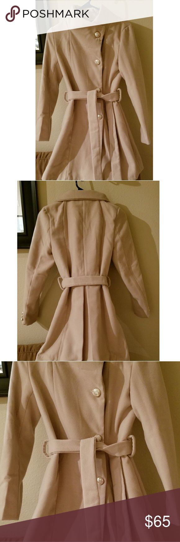1 hr flash sale! Cream colored coat Coat is a lovely cream color and has gold buttons (which are a bit loose, but that can be an easy fix). The belt cinches the waist for a very flattering look. There is fraying and it needs to be ironed/steamed, but I've hardly worn this item and believe there is still plenty of life left in it. I'm open to offers. Price dropped! Hoping the price makes up for the pilling/fraying. Jackets & Coats Pea Coats