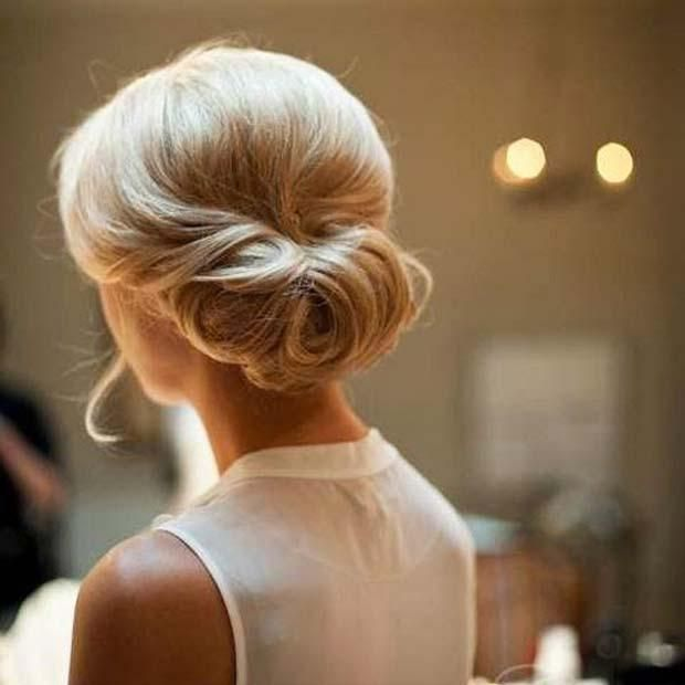 The Tuck Up Do | Hairstyle | Bridal Hair | http://blog.thelovelustlist.co.uk/15-wedding-hairstyles-for-the-modern-bride-blow-ltd/
