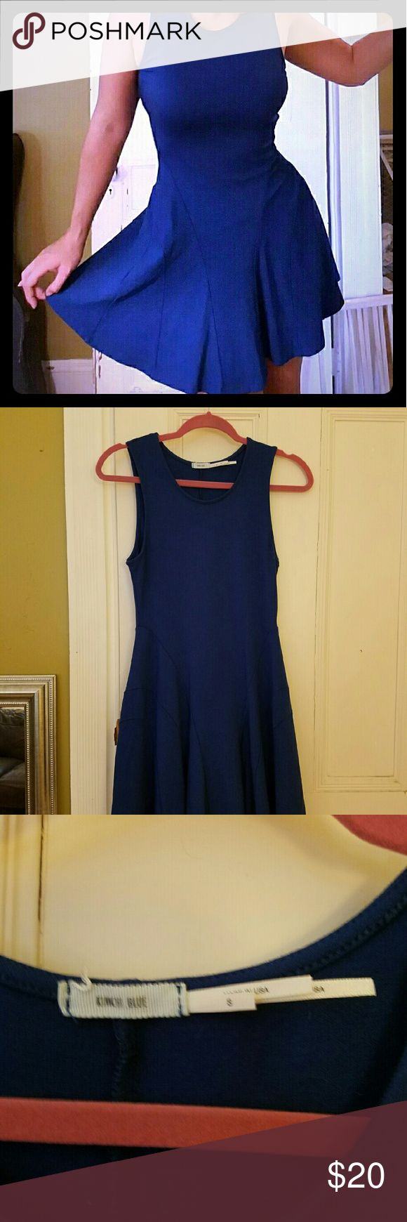 UO Blue Pleated Dress This simple, elegant dress is perfect for any occasion! Dark blue with pleating in the front, the cut is somewhere between drop waist and fit-and-flare. Urban Outfitters Dresses