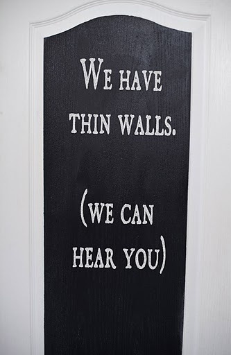 If one is brave enough (has time to) make and hang this sign, one should have the skills/time to apply a carpet on the door back to buffer bathroom sounds. Just saying...