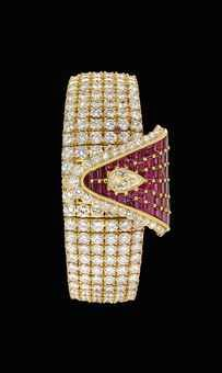VERY RARE IMPRESSIVE AND POSSIBLY UNIQUE 18K GOLD, DIAMOND AND RUBY-SET BRACELET WATCH WITH CONCEALED DIAL