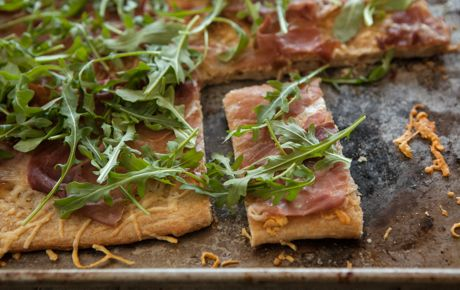 PARMIGIANO REGGIANO, PROSCIUTTO AND ARUGULA FLATBREAD. Serve this flavor-packed flatbread as a starter or side.