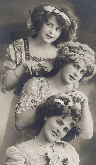 victorian beauty. I love the dresses, hair, accessories. Beautiful portrait.  It looks like sisters just having fun