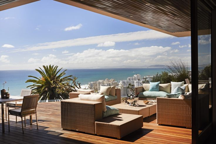 The entertainment #deck at Ellerman House Villa One overlooking the Atlantic Ocean and private infinity #pool.  #LuxuryHotel #interior #architecture