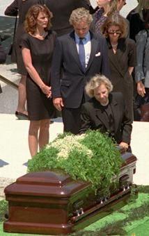 ETHEL KENNEDY kneels at the coffin of JACQUELINE KENNEDY ONASSIS during funeral services at Arlington National Cemetery.  Behind Mrs. Kennedy is Rep. Joseph Kennedy II, D-Mass., his wife Beth, left, and his sister Kathleen Kennedy Townsend.  -- May 23, 1994