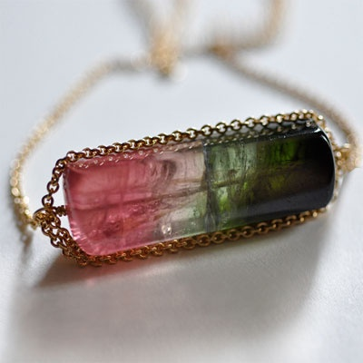 Love the way this tourmaline crystal is chain-wrapped instead of wire-wrapped.