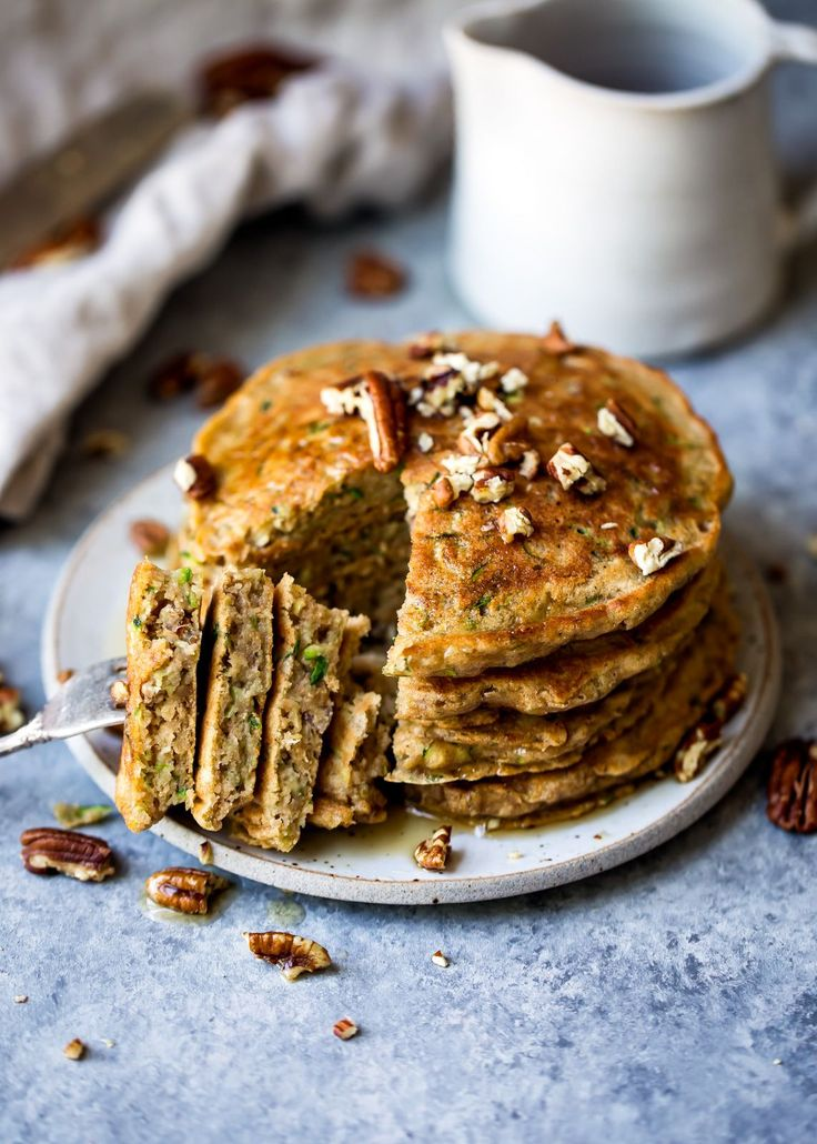 Fluffy whole wheat zucchini bread pancakes with hints of cinnamon and nutmeg. These pancakes taste like a slice of your favorite classic zucchini bread. Add chocolate chips or pecans if you'd like!