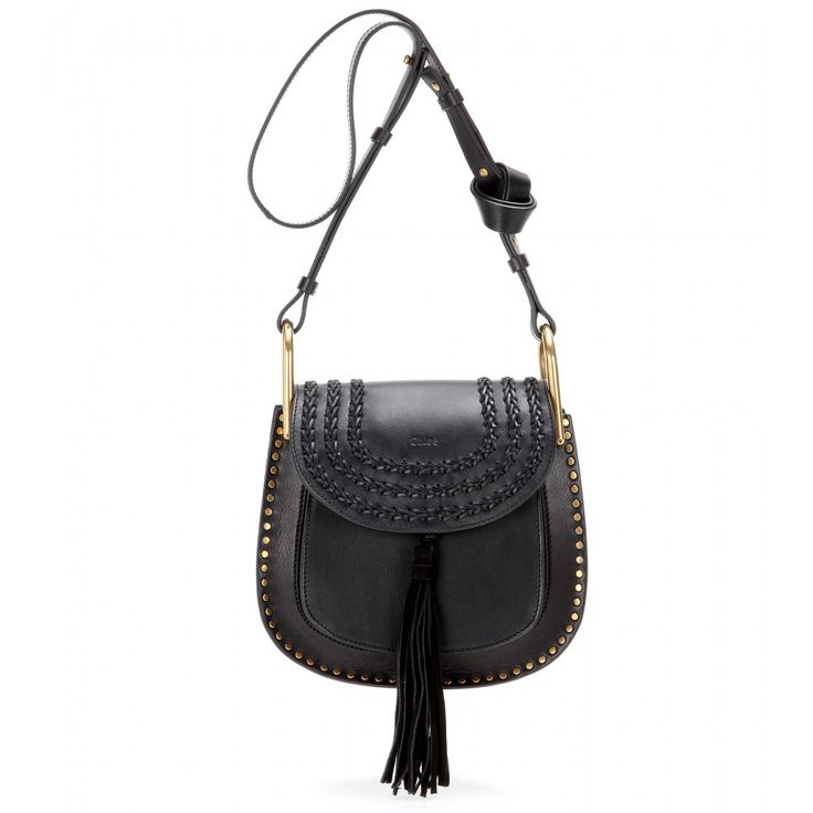 Chloé - Hudson Small leather shoulder bag - With gold-tone hardware and exaggerated stitched detailing, the 'Hudson' shoulder bag from Chloé is a romantic, bohemian dream, with the hanging tassel sealing the deal. Note the knot in the strap that adds a casual touch. Wear with a floaty floral skirt for real hippie style. seen @ www.mytheresa.com