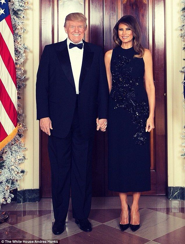 The Trumps' 2017 Christmas portrait was was revealed on Melania's Twitter page on Thursday afternoon, The couple was photographed in front of the Blue Room in the White House.