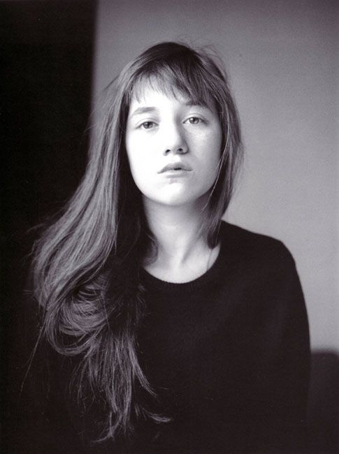 Charlotte Gainsbourg. Her fringe is choppy and not very thick so she usually wears it parted somehow. Her forehead is low to medium and her face shape is long and... oval? yet boxy?