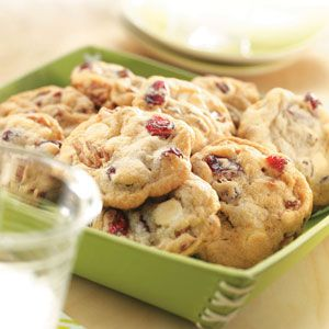 CRANBERRY PECAN WHITE CHOCOLATE COOKIES - •1 tube (16-1/2 ounces) refrigerated sugar cookie dough, softened •1 cup chopped Diamond of California® Pecans •2/3 cup vanilla or white chips •2/3 cup dried cranberries •1 teaspoon vanilla extract