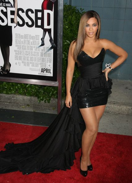 Beyonce dressed in a dramatic black Balmain dress with sweeping train.