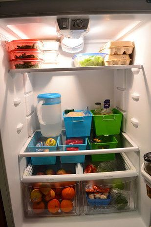 Organize your fridge with a few small bins. | 16 Smart Dollar Store Ideas To Organize Your Kitchen