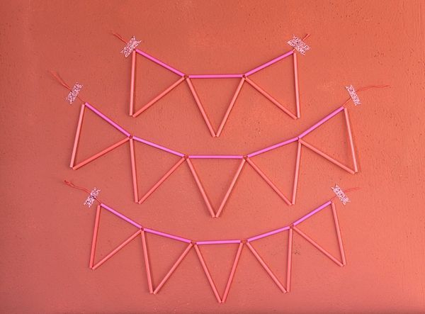 I was making a himmeli last week and had a ton of pink and coral straws leftover and suddenly I realized I could string up a bunch of triangles and have a new kind of bunting! I love that it's got negative space, is three dimensional, and won't get easily...