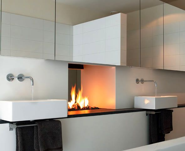 a two-sided fireplace that opens up onto the master bathroom and bedroom. cozy + modern.