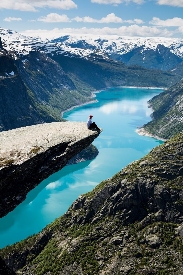 """Trolltunga, Norway - """"Tip of the tongue,"""" known as one of the most spectacular hikes in all of Norway. The little ledge of a cliff juts out, holding you more than 3,600 feet above sea level"""