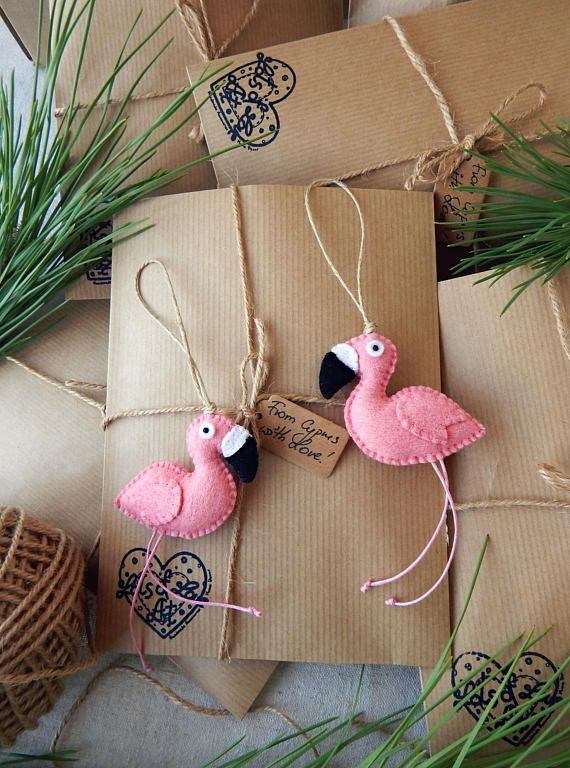 Two flamingo ornaments.A pair of Christmas flamingos.Pink