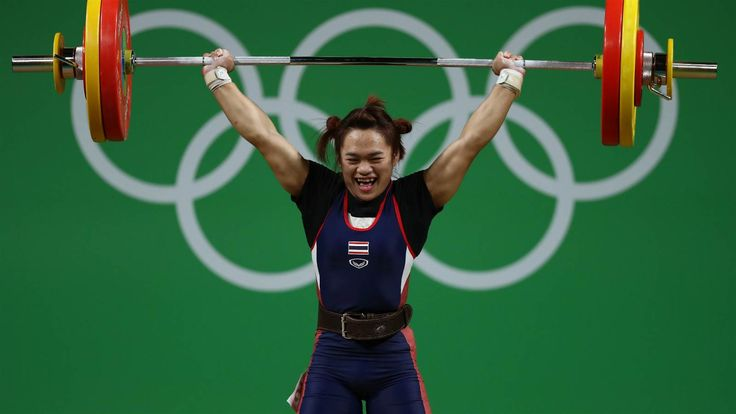 OR: Sukanya Srisurat of Thailand shows her joy after setting an Olympic Games weightlifting record, with a 110kg lift in the women's 58kg