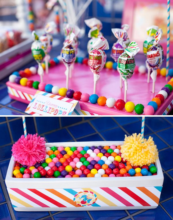 cut a small piece from a large styrofoam sheet for the base, covered it with wrapping paper, and embellished the edge with gumballs and a band of the multi stripe paper.    Great for cakepops