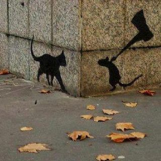 Street art...awesome stuff!(This one looks more like a couple of images pasted on a picture. The cats front leg is way out of proportion.)