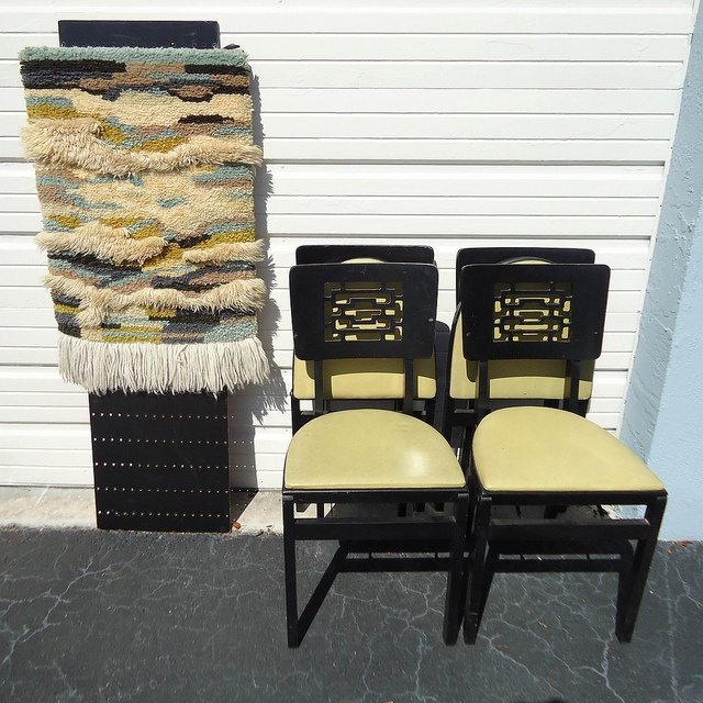 4 vintage Stakmore folding chairs with an asian feel + mod handmade latch hook wall hanging with a slight southwestern feel. Funny how they kinda work together!  My Aunt had those chairs when I was a kid... hers had red seats!