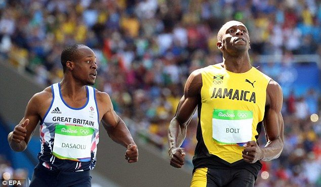 James Dasaolu (left) of Britain and Usain Bolt (right) of Jamaica react after competing during the men's 100m heats of the Rio 2016 Olympic Games