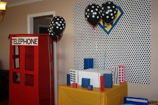 cake table (minus the cake) and the phonebooth at our superhero party