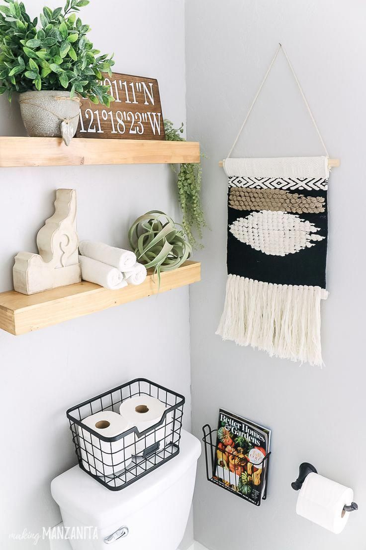 Love how she decorated these shelves above the toilet in this boho farmhouse bat…   – bathroom shelves