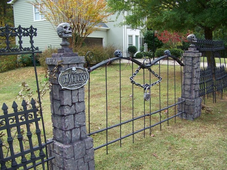 skull wood fence diy - Google Search | Cemetery Entrances ...