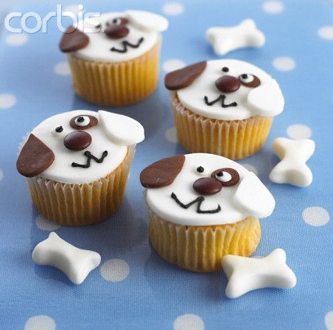 dog decorated cupcakes | Cupcakes Decorated Like Puppy Dog Faces - 42-20130678 - Rights Managed ...