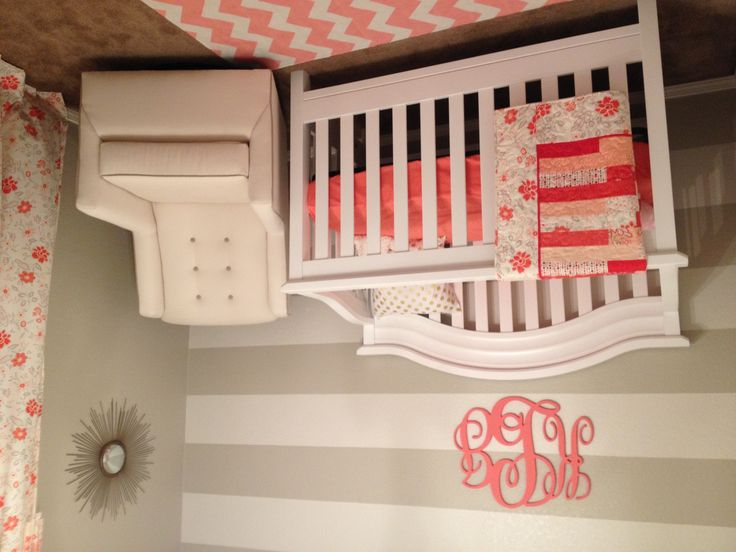 When I found out I was having a girl, I knew I wanted a girly nursery. I didn't want the traditional pink nursery, so I went with a coral and taupe nursery.