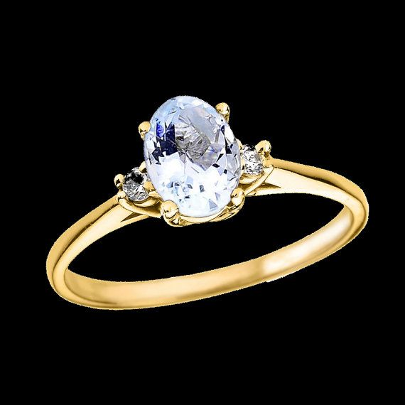 La aguamarina Oval oro amarillo y anillo de propuesta de compromiso de diamante.  Metal: Oro amarillo  Centro de piedra: Aguamarina genuino Tamaño y forma: Oval, 6,8 mm 4,8 mm Peso en quilates: 0,60 ct (aproximado)  Piedras laterales: 2 diamantes Tamaño y forma: redondo, 2 mm Diamantes claridad: I1 Peso total quilates: 0,05 ct (aproximado)  Ancho de banda: 1,5 mm  Peso: 1,70 gramos  Final: Alto pulido.  Disponible en pureza de 10k y 14 k de oro.  [[Q2810]]  (: Hecho en los E.e.u.u. :)