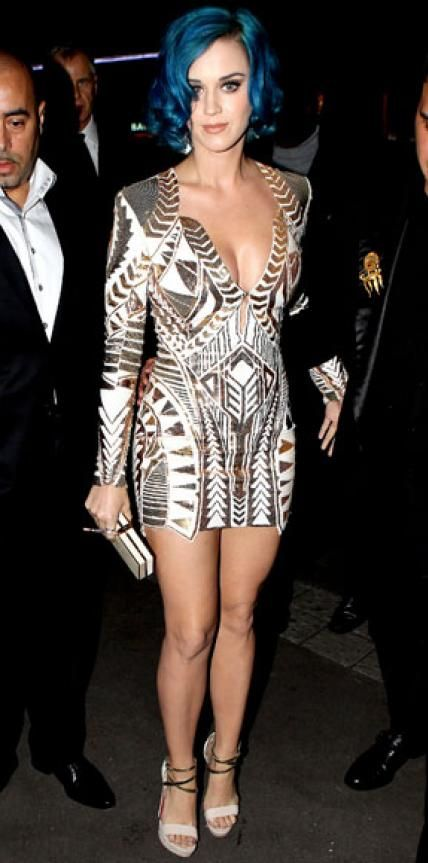 Look of the Day › March 3, 2012 WHAT SHE WORE Perry struck a pose in an embellished Balmain minidress and ankle-strap Christian Louboutin sandals outside France's La Maison du Caviar restaurant