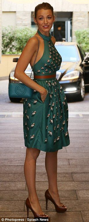 Flirty and fabulous: Earlier in the day, Blake was seen looking chic in a patterned green dress