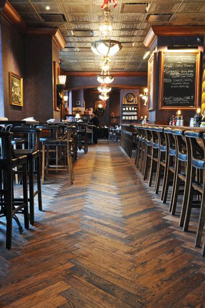 Herringbone floor made from reclaimed equine fencing by Schmidt Custom Floors Inc. in Waukesha, Wis
