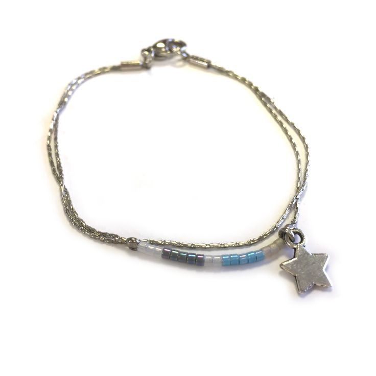 Alice bracelet by One Button – japanese seed bead double line – silver w/silver star #ice #pastel #beautifulblues #bracelet #accessories #onebutton  Click to buy from the One Button shop.